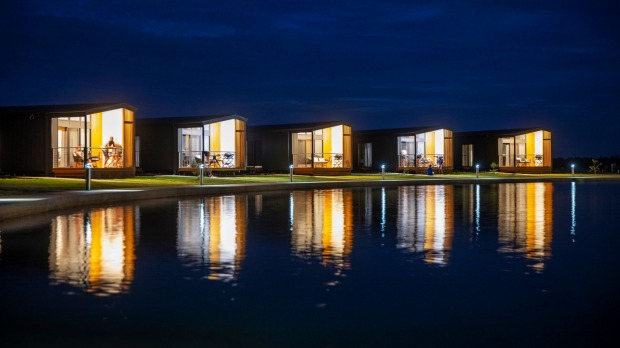 """The lakeside """"villas"""" are, in reality, glorified shipping-container-like cabins starting at a generously-sized 52.3 metres."""