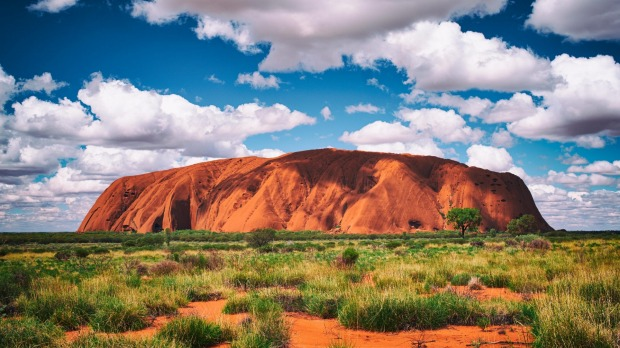 Uluru, Northern Territory, Australia - March 29, 2016: Fluffy clouds drift over Uluru (also known as Ayers Rock) in the Australian Outback. A genuine Wonder of the Natural World (and a UNESCO World Heritage Site), it's also a sacred place to the local Anangu people. satmar27cover Photo credit: iStock Reusage permitted for print and online