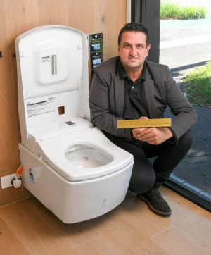 Dominic Polito, sales manager at Sirius Design in South Melbourne with the top-of-the-range toilet.