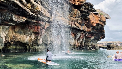 Guests can take kayaks and SUPs beneath waterfalls and beside intricate sandstone cliffs.
