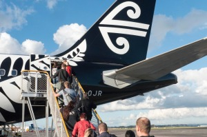 Auckland, New Zealand - May 29, 2015: Air New Zealand Flight 455 passengers boarding, departing for Wellington New Zealand
