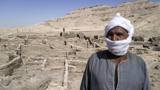 """A worker at the site of a 3000 year-old lost city in Luxor, Egypt. Egyptian archaeologists have discovered Aten or """"the ..."""