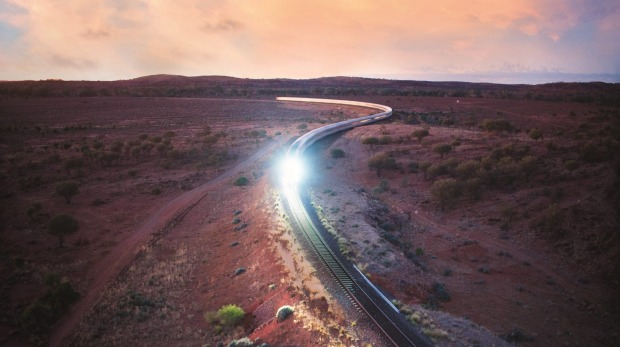 The Indian Pacific heading towards Broken Hill at dawn.
