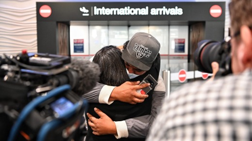 Emotions bubble over: Passengers arrive at Auckland airline after the first trans-Tasman bubble flight.
