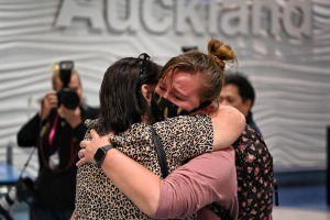 Emotional scenes as passengers arrive at Auckland Airport on the first trans-Tasman bubble flight.