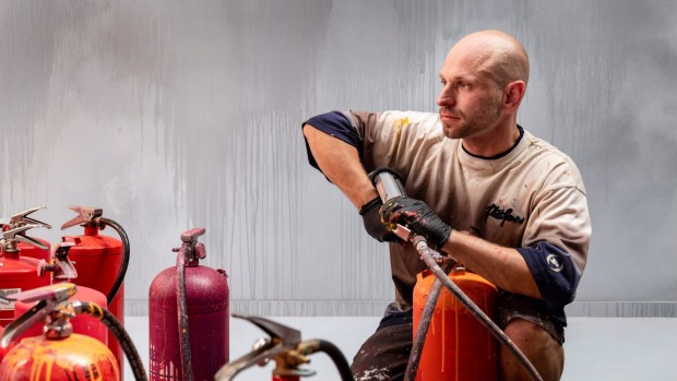 Ash Keating uses paint-filled fire extinguishers to create his giant works.