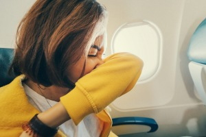 Is it COVID-19, or just a sneeze? Hay fever sufferers face a travel dilemma.