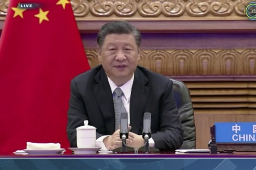 China's President Xi Jinping speaks during the virtual leaders' summit on climate.