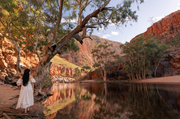 Ormiston Gorge offers contrast between the spectral white trunks of the ghost gums and the eye-watering blue of the ...