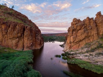 Sitting 130 kilometres west of Alice, Glen Helen Gorge holds water throughout the year. Right now, the pool gathered ...