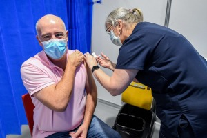 Getting the COVID-19 vaccine at Melbourne's Exhibition Centre. One reader believes vaccinated Australians should not be ...