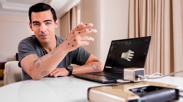 Expedia used a 3-D printer to make resin replicas of singer-actor Joe Jonas's right hand.