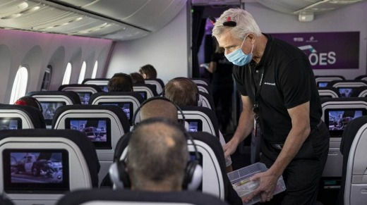 Air New Zealand chief executive Greg Foran hands out ice blocks on Saturday's flight.