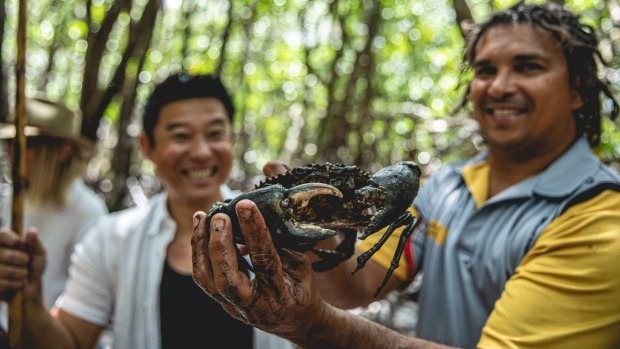 Juan Walker (right) from Walkabout Adventures with the now-famous mud crab.