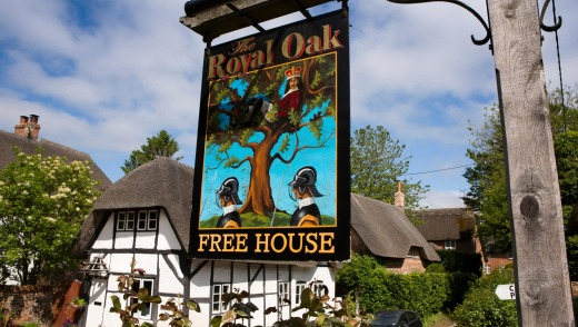A sign for a Royal Oak pub in Wiltshire, England illustrates the story behind the name.