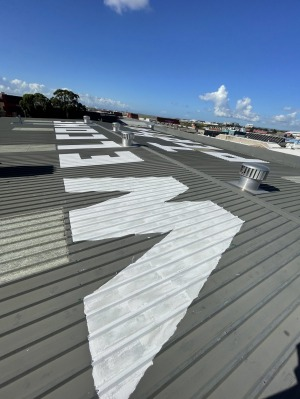 The rooftop prank was done in road paint, making it highly visible.