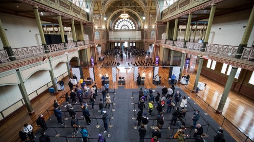 People queue to get their vaccinations in the Royal Exhibition Building.