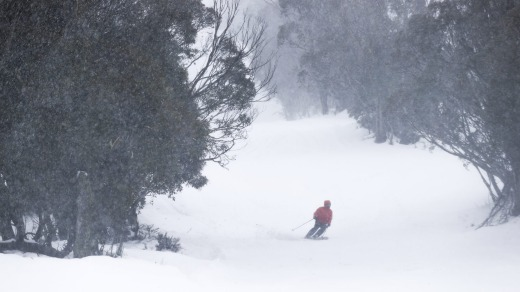 Snow falling during opening day of the ski and snowboard season at Thredbo on Saturday.