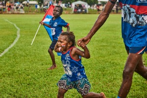 Young fans run on to the ground at the Tiwi Islands Football Grand Final.