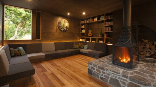 After a day in the saddle, riders can stretch out on the l-shaped lounge surrounding the French fireplace.