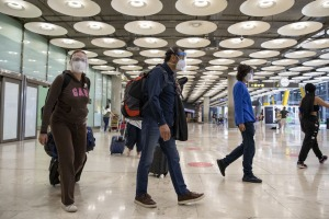Passengers arrive at Adolfo Suárez Madrid-Barajas airport in Madrid, Spain. Spain is open to to vaccinated visitors ...