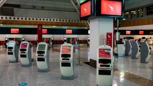 Sydney Airport's domestic terminal sits empty during the city's lockdown as other states close the borders.
