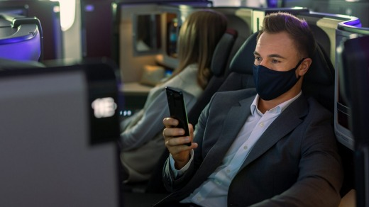 The new business class seats feature wireless charging for mobile devices.