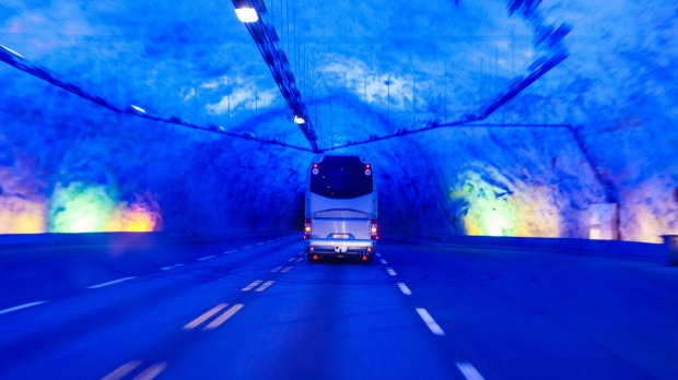 The lighting inside Laerdal Tunnel in Norway has been designed to replicate a sunrise so drivers don't get bored.