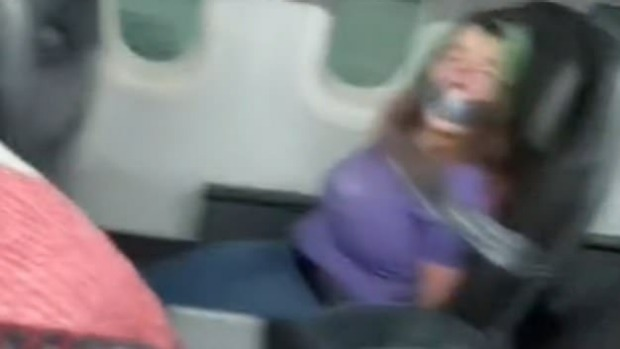 An unruly plane passenger on an American Airlines plane was duct-taped to seat.