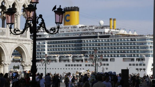 A cruise ship passes by St. Mark's Square in June, 2019.