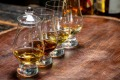 Tasting of flight of Scotch whisky from special tulip-shaped glasses on distillery in Scotland, UK close up iStock image ...