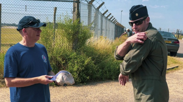 US Air Force Major Grant Thompson ripping the flight patch from his shoulder to give to Ian Simpson, who spotted the ...