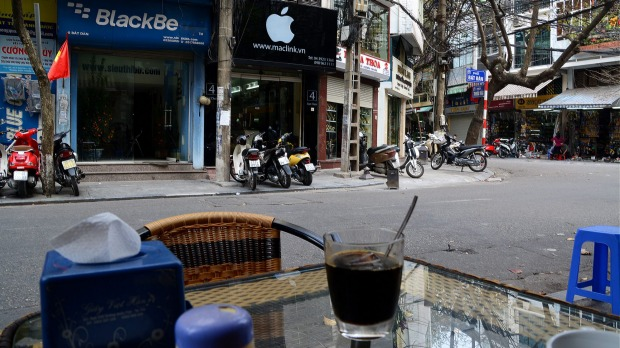 Hanoi. In Vietnam, your coffee comes with a side order or motorbike exhaust fumes.