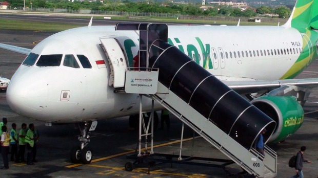A flight attendant aboard a Citilink plane noticed the man change the clothes in the lavatory.