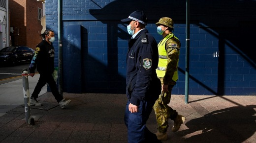 A member of the NSW Police Force and the Australian Defence Force patrol the streets of Bankstown, Sydney this week.
