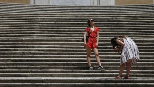 Tourists take photos at the Spanish Steps in Rome in June after the government removed its masks outdoors rules.