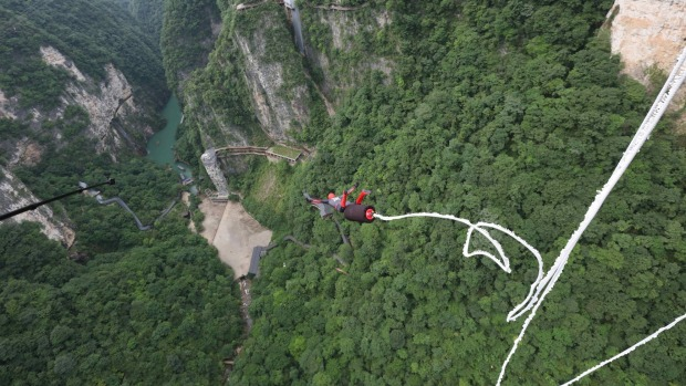 Visitors to the Zhangjiajie Grand Canyon Glass Bridge can take a leap from a height of 260 metres.