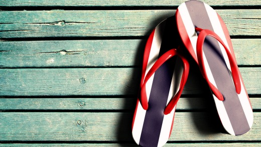 Wearing shoes depicting the Thai national flag, like these flip flops, could get you fined or even a year in prison.