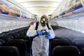 A maintenance worker disinfects an aircraft at Ben Gurion Airport in Tel Aviv, Israel. Despite its high vaccination ...