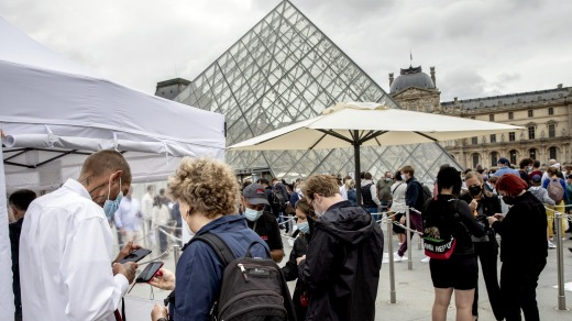 Visitors show their pass to enter the Louvre museum in Paris on Friday. They must show proof of COVID-19 vaccination or ...