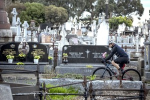 18/08/21 Melbourne cyclist Rob Cianflone rides through the Melbourne General Cemetary, Parkville. Photograph by Chris ...