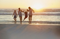 Family time with the sun setting over the sea at WA's Cable Beach.