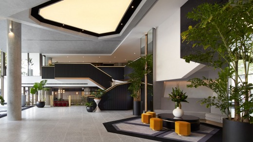 The two-storey lobby looks like the showroom of a designer furniture store.