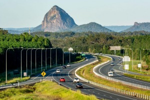 The Bruce Highway, looking south past Mount Tibrogargan in the Glasshouse Mountains, in Queensland. A fabulous road trip ...