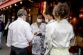 Women show their health passes to a waiter in Paris early this month.
