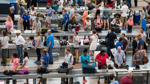 Passengers wait to have their bags screened in Denver, Colorado.