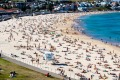 Crowds at Bondi Beach last weekend. Convincing Australians to holiday at home will be difficult once international ...