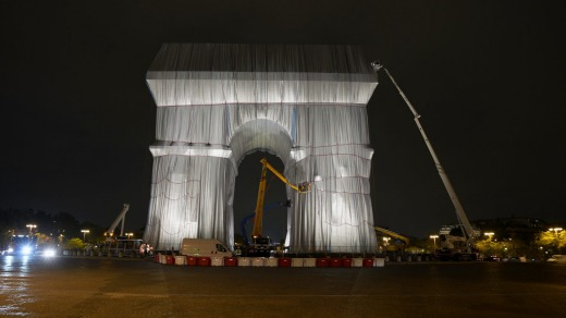 Workers wrap the Arc de Triomphe monument on Wednesday.