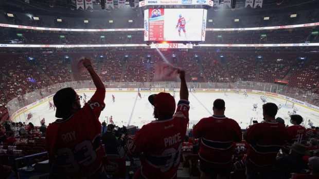 Montreal Canadiens fans cheer prior to Game 4 of the NHL hockey Stanley Cup Final against the Tampa Bay Lightning in ...