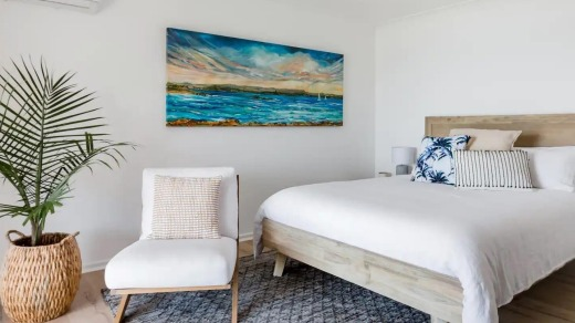 Go to sleep to the sound of waves crashing on Blacksmiths Beach and wake to sparkling water views from the master bedroom.
